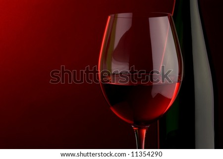 a glass and bottle of red wine - stock photo