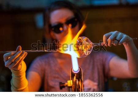 A glass blower melting glass Foto d'archivio ©