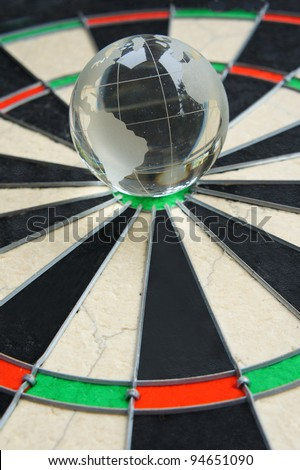 a glass globe in the middle of dart board