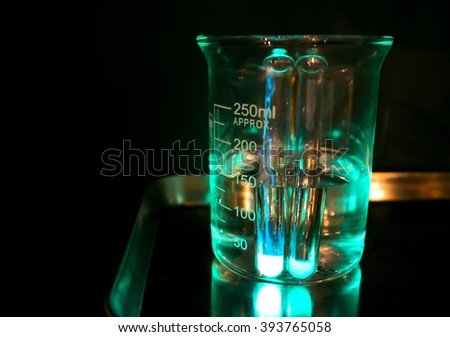 A glass in a chemical laboratory, glass in green light, chemical science photo illustration, chemical experiment with liquid i glass, medical experiment in dark laboratory, glowing glass with chemical