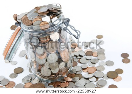 A glass jar full of British coins.