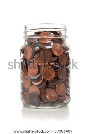 a glass jar full of coins