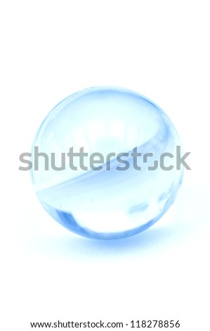 A Glass marble on white, high key