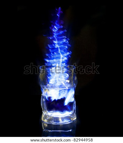 a glass of a blue energy drink