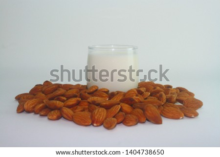 A glass of almond milk with almonds seed #1404738650