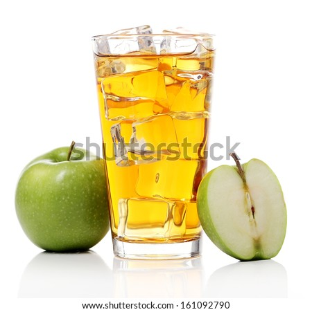 A glass of an apple juice with ice and some apples lying around over a white background #161092790