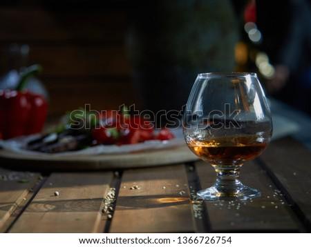A glass of brandy. #1366726754