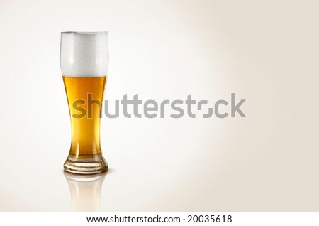 A glass of cold beer on a white background
