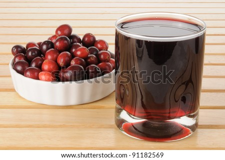 A glass of fresh cranberry juice