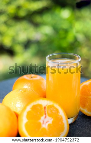 A glass of fresh orange juice served for detox beverage. Fresh detox orange juice poured in glass for juice diet refreshment. Fresh detox orange juice can boost vitamin C. Healthy lifestyle concept.