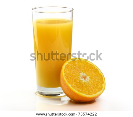 A Glass of freshly squeezed Orange juice with Fruit on a white background.