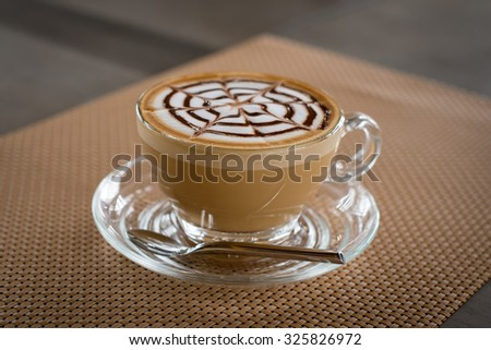 a glass of hot latte art coffee #325826972