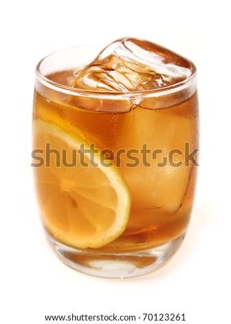 a glass of iced cool lemon tea with slices of lemon