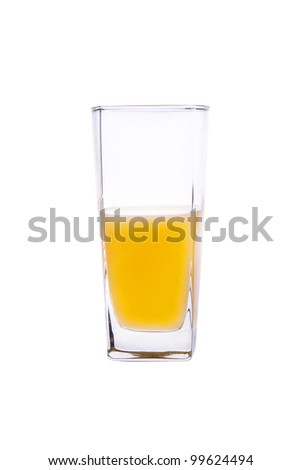 A glass of juice. Half of the glass, shot on white background