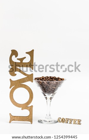 A glass of martini and fragrant coffee and the inscription love and the inscription coffee #1254399445