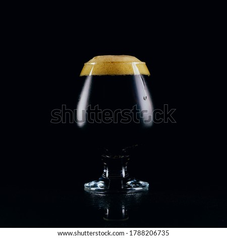 A glass of porter beer  on a dark background Stock photo ©