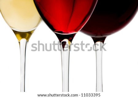 a glass of red, white and rose