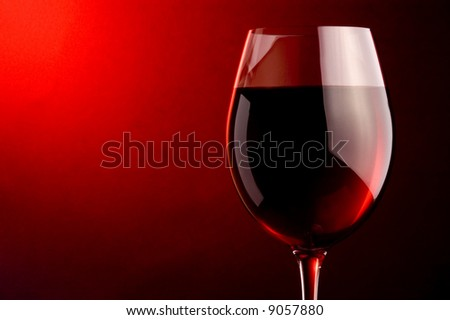 a glass of red wine - stock photo