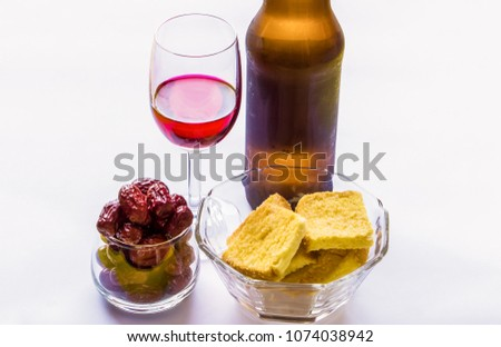 Stock Photo A glass of red wine and a bottle with bread and fruit isolated on white background.