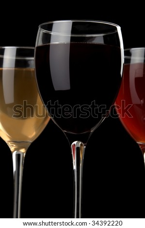 a glass of red wine and a glass of white wine at black background