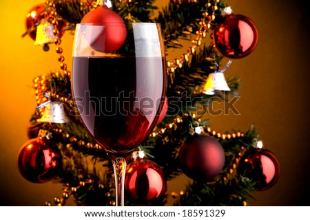 a glass of red wine and Christmas tree