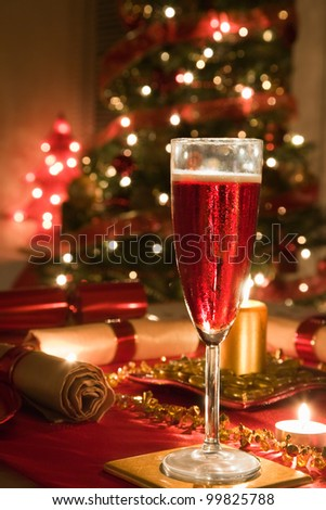 A Glass of Rose Champagne on a decorated Christmas day dinner table