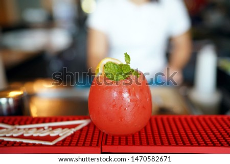 A glass of Watermelon cocktail with lemon and mint leaves on blurred background and copy space, Cold refreshment organic non-alcohol drink, Summer refreshing mocktail. #1470582671