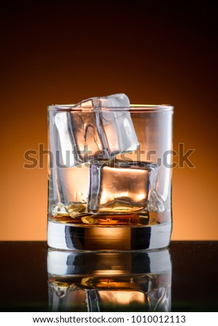 A glass of whiskey with ice #1010012113