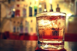 a Glass of whisky on the bar