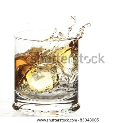 A Glass of whisky with ice cube splash isolated on white