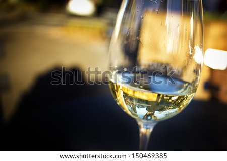 A Glass Of White Wine In An Isolated Background.