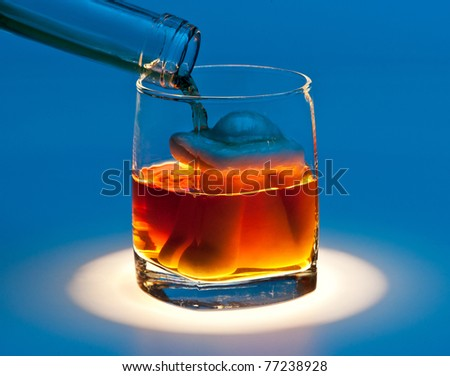 A glass with a woman figure inside and an alcoholic drink flowing in, blue background