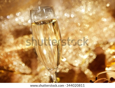 a glass with champagne in festive decoration #344020811