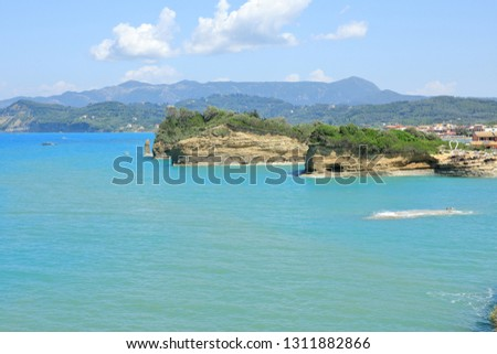 A glimpse to formations around the Small d'Amour Canal and the village of Sidari, Corfu Island, Greece, Europe Canal d'Amour (love channel) is a great nature's masterpiece carved by sea and wind.