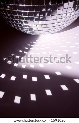 a glitterball reflecting bright shapes on the floor