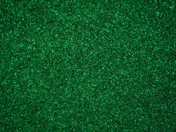 A glittery green paper. Silver glitter light bokeh abstract texture. Pattern designs. Sparkle wallpaper for Christmas. Brilliance shimmering sequin background. Party time.