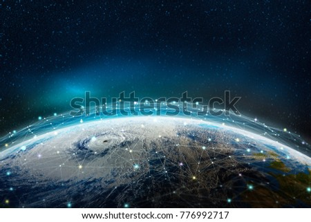 A global social, information network across the planet, view from space. The earth is surrounded by a web of digital data. Elements of this image furnished by NASA #776992717