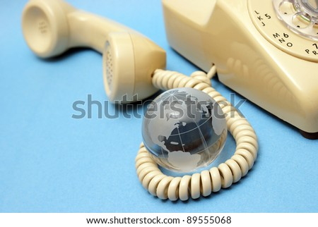 A globe and rotary phone represent global communications.