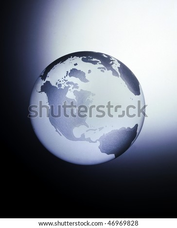 A globe made of glass with the main view of North America, Central and South America with space for copy