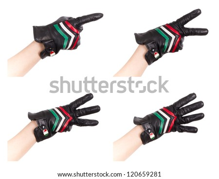 A gloved hand counts