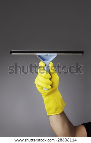 A gloved hand holding a squeegee