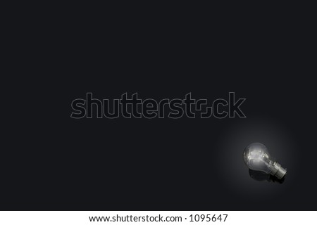 A glowing lightbulb on a black background