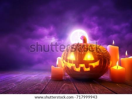 A glowing Pumpkin Jack-O-Lantern against purple sky background on Halloween, mixed media illustration.