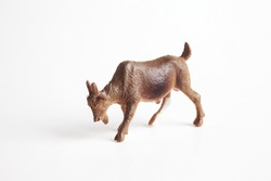 A goat  plastic toy for kids isolated on white background