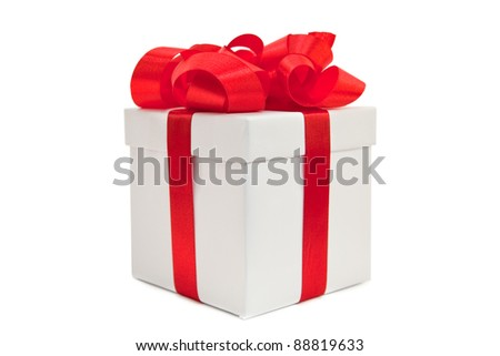 A gold box tied with a red satin ribbon bow. A gift for Christmas, Birthday, Wedding, or Valentine's day. Isolated on white with clipping path.