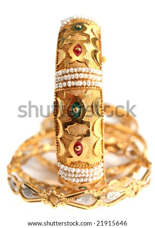 A gold bracelet with small natural Gulf pearls and inlaid with enamel, in the Arab style.