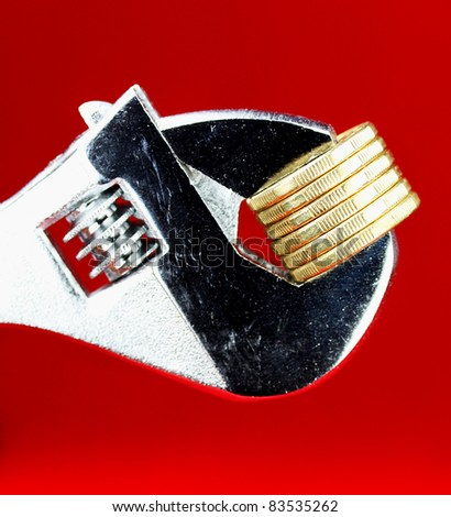 A Gold Dollar Coin being squeezed in a silver adjustable spanner, against a red background and asking the questions how tight  is you household budget?
