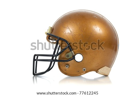 A gold football helmet on a white background