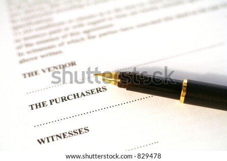 A gold-nibbed fountain pen resting on a contract for the purchase of property in the EU