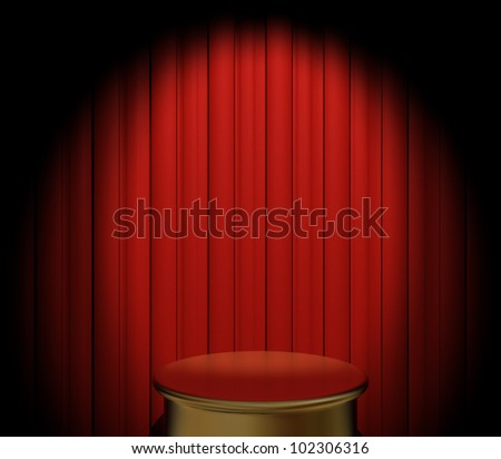A gold pedestal in front of a red velvet curtain with spotlight